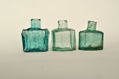 almost infinite possibilities (polydaktyl) Tags: light glass aqua victorian angles octagonal inkbottles boatshape