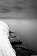 Iced Breakwater (John A. Gessner Photography) Tags: longexposure winter sky blackandwhite bw lake snow ice water clouds landscape rocks michigan north le iced frankfort