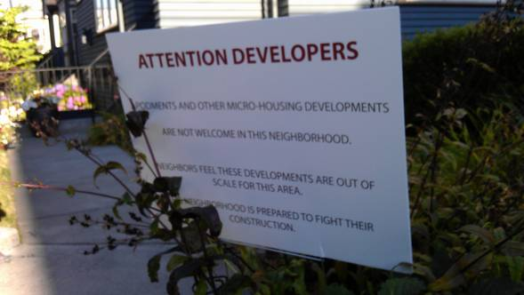 These anti-apodment signs appeared suddenly just off 15th Ave E this summer. The Reasonable Density Seattle group has since claimed responsibility.