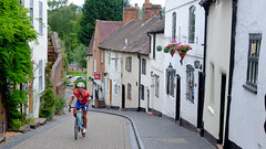 Uphill struggle. (James- Burke) Tags: bridgnorth cycling cyclist england houses man red shropshire speedmovement travel