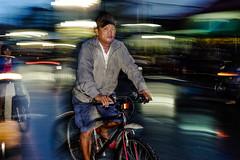 Rainy night (-clicking-) Tags: life bicycle night ride nightshot streetphotography streetportrait streetlife vietnam riding nightlight dailylife panning saigon streetnight