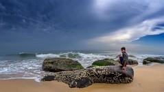 Bay watch (rameshsar) Tags: 8mm kovalam surfing rokinon xe2 boy sea clouds landscape