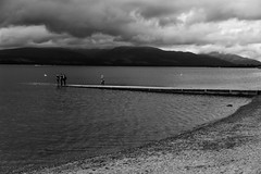 Balloch Slipway (Gary Ellis Photography) Tags: balloch lochlomond scotland summer uk westdunbartonshire adult afternoon bw beach beautiful beauty blackandwhite boatlaunch cheerfulness daytime environmental exterior female gorgeous groupofpeople happiness happy highlands hill historic holidays hot joy lake landscape liquid loch male man mountain old outdoors outside park photographing profile recreation scenic shallowdepth sideon sideview slipway standing sunshine unitedkingdom warm water wet woman young