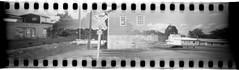 Railroad Crossing (Defunct Train Line) (New Paltz Camera Company) Tags: railroad crossing tracks sign walden ny new york bob esposito hudson river valley 35mm pinhole blender kodak trix 400 expired film xtol 11 developer epson v600 scanner black white monochrome analog analogue train