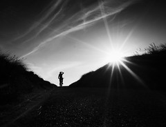 Escaping the Sun (Dan-Schneider) Tags: streetphotography street silhouette sun sunset olympus omdem10 monochrome blackandwhite bw light solitude minimalism mood