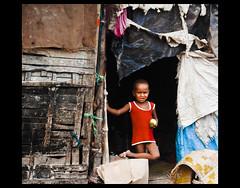 An Apple A Day? (Birabrata.Das) Tags: poverty red urban apple canon child indian poor health needs issues kolkata slum urbanpoverty slums minimum vulnerable