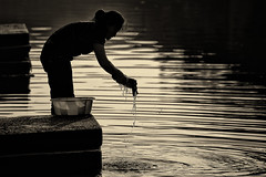 washing at sunrise~ Xitang (~mimo~) Tags: life china light people woman water monochrome sunrise fence golden bucket clothing domestic xitang ripples washing hff