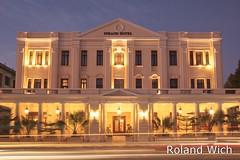 Yangon - Strand Hotel (Rolandito.) Tags: road blue light strand hotel twilight stream traffic dusk yangon burma trails hour myanmar birma nightfall bleue rangoon blaue birmanie stunde lheure birmania rangun