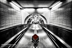 Channel of Descent (Aaron Yeoman) Tags: city uk greatbritain travel red england urban blackandwhite bw london lines station metal architecture modern vanishingpoint blackwhite europe unitedkingdom curves perspective thecity railway tunnel line gb tubestation londonunderground subwaystation curve vignetting vignette thetube cityoflondon metrostation a77 bankstation lul theunderground undergroundstation squaremile northeastlondon bankundergroundstation banktubestation sigma1020mm1456exdchsm sonya77 bankmonumentstation banktravelator banktravolator slta77 sonyalphaslta77 bankmonumentundergoundstationstation bankmonumenttubestation bankmonumentundergoundstation