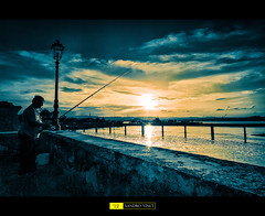 Il pescatore - the fisherman (Sandro V-R ) Tags: sunset cloud sun color love colors sunshine silhouette clouds lens landscape golden amazing fantastic nikon gate tramonto photographer emotion cloudy ponte filter nd sicily augusta colori sicilia graduated dx contrasto d80 sandrovinci