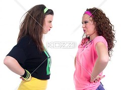 angry young females standing face to face (hannapeople2012) Tags: standing photography women anger indoors angry arguing females sideview youngadult facetoface problems twopeople adultsonly furious caucasian displeased makingaface colorimage handonhips waistup onlyyoungwomen 2024years physicalstance