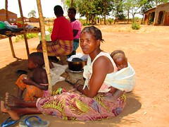 Sleeping Baby (Allan Rickmann) Tags: poverty africa road boy woman baby sun girl capital mother stall son vegetable shade malawi roadside motherhood development mzuzu dowa lilongwe warmheartofafrica
