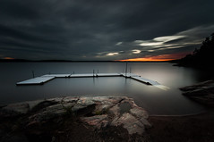 Nightfall II (- David Olsson -) Tags: longexposure summer lake water clouds landscape evening pier sand nikon rocks sundown cloudy sweden dusk jetty tripod sigma august cliffs le late 1020mm 1020 vnern 2012 dx brygga vrmland orangeglow ndfilter lakescape grums smoothwater smoothsky 2exposures badplats minibeach slottsbron d5000 floatingpier manualblend scenicsnotjustlandscapes manuallyblended davidolsson nd500 lightcraftworkshop grumsfjorden mickelsn darkskyheavyskysunset