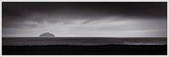 Lump in the Landscape: West Coast Evening (spodzone) Tags: sea sky blackandwhite panorama motion blur art nature water composite clouds manipulated lens landscape photography islands scotland raw emotion space dramatic gimp places equipment negativespace duotone isolation pentacon hazy awe distance toned contrasts stacked lightanddark ayrshire turnberry selenium ailsacraig painteffects crazyart digikam tonemapped landwater skyearth rawconversion pentacon50mm enfuse rawtherapee luminancehdr darktable motionstationary