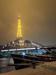 Eiffel Tower + snow + Passerelle Debilly + boat