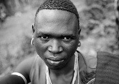 Man At Tum Market, Omo Valley, Ethiopia (Eric Lafforgue) Tags: africa people blackandwhite man male face look horizontal collier outside outdoors person necklace noiretblanc market portait headshot omovalley marketplace ethiopia tum personne humanbeing marche homme tete visage regard contemplation afrique headandshoulders dehors omo eastafrica abyssinia ethiopie exterieur lookingatcamera traditionalclothes toum blackandwhitepicture abyssinie vueexterieure menit afriquedelest etrehumain habittraditionnel photoennoiretblanc meinit valleedelomo regardantlobjectif peoplesoftheomovalley teteetepaules peuplesdelavalleedelomo peuplemenit menitpeople tribudesmenits menittribe meinitpeople meinittribe ethiopia1098