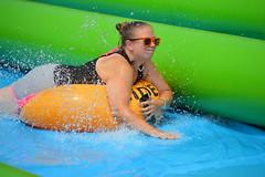 Splash sliding (radargeek) Tags: slidethecity oklahomacity oklahoma waterslide splash sunglasses