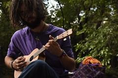 Connor (Alick Boych) Tags: ukulele hippie hippy dreads deadlocks summer sun sky up trees people man music rhythm ring necklace
