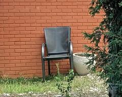 probably the employees' smoking lounge (muffett68 ) Tags: emptychair smokingarea hbm