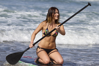 Girl paddleboarding for a Travel Channel photo...