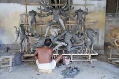 An Artist works on Clay Idols, Kumartuli (Kumortuli) (Rajesh_India) Tags: india west religious god kali religion goddess idol ritual indians utsav kolkata bengal calcutta durga 2012 durgapuja godess bengali ghat westbengal bangali kumartuli kumartoli kumortuli