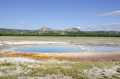 Prismatic Springs (M. Malone) Tags: blue sky orange nature water clouds nationalpark spring pretty pools minerals yellowstone prismatic highcolour