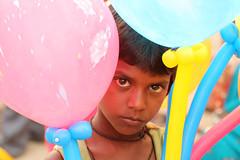 Child selling balloons (Marco Monzio C.) Tags: portrait people india balloons ganesha child mumbai incredible chaturthi 2012
