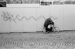 Torgallmenningen (varjagg) Tags: leica old norway fence 50mm graffiti october cyclist kodak f14 cobblestone bergen 13 summilux m4 v2 2012 plusx leitz ei200 5231 microphen e43 preasph