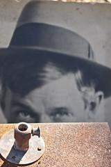 playful peek (lucymagoo_images) Tags: man texture hat metal contrast pen vintage photo eyes whimsy artistic market olympus hidden flea juxtaposition playful whimsical epl1 lucymagoo lucymagooimages