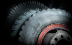 spare (Steven Schnoor) Tags: red orange black color art wheel canon dark photo rust colorful photographer image picture tire tires photograph rim vignette corrosion schnoor simplelogic