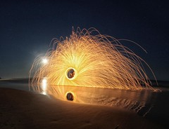 Whirl (pominoz) Tags: moon reflection beach fire steel nsw sparks thechallengefactory woolwire woolcaves