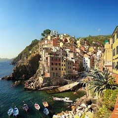 The best classical view on Riomaggiore (Bn) Tags: world ocean park flowers blue trees houses sea summer vacation cactus sky orange sun sunlight holiday flower tower heritage classic water colors beautiful weather train buildings walking coast boat high topf50 warm mediterranean italia day sailing ship torre gulf hiking path five liguria shoreline hike case cliffs lovers quay historic unesco via clear national wharf terre sail botanic mountainside quaint incredible viewpoint picturesque coloured topf100 cinque adriatic riomaggiore italianriviera torri yellew dellamore 100faves 50faves guardiolas