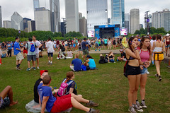 looking for someone (KevinIrvineChi) Tags: twins pair couple converse all star stars lollapalooza chicago 25 25th anniversary concert outdoors outside outdoor grass lawn grassy smoking smoke cigarette close shorts stage skyline illinois chicagoist grant park blue pink red overcast gray crowd audience bud light sony dscrx100 girls smartphone phone calling fanny packs sitting standing waiting backpack camelbak concerned people peoplewatching festival festive party
