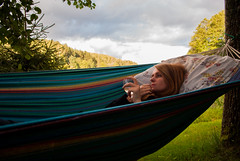 Relaxing (modestmoze) Tags: girl woman glass wine nature outside outdoors 2016 500px sky clouds white grey sunny blue hammock pillow comfortable relax chill relaxing chilling summer august lines strings trees treeline grass green shadows brown leaves orange hair face hand holding day