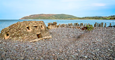 Sea erosion has led to the collapse of a World War II strong post, or 'pillbox' at Porlock Weir in Somerset (Anguskirk) Tags: wwii bunker england landscape pillbox porlockbay porlockweir somerset strongpost topazdenoise type24 uk worldwar2 beach pebbles sea
