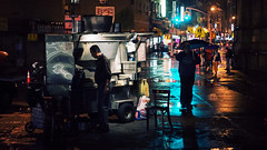 Business as usual. (Linh H. Nguyen) Tags: life street light shadow urban food newyork colors rain night reflections lights chinatown vendor moment cinematic