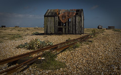 Dungeness (Steve's Photography :-)) Tags: uk england sky beach canon boat kent track desert shed shingle rail hut dungeness wreck 550d steveclancy cloudspebbles