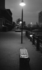 Street light and Benche (Snap Shooter jp) Tags: street blackandwhite bw film monochrome japan night bench streetlight snapshot stock earlymorning rangefinder snap contax hp5 yokohama ilford aria blackdiamond sakuragicho xtol ei200 distagon35mmf14 flickrestrellas mygearandme