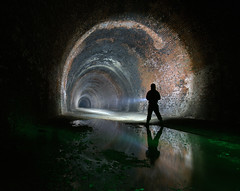Does it ever end ? (Kriegaffe 9) Tags: light shadow water silhouette dark arch bricks railway tunnel torch figure brickwork lenser x7r