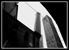 Two Towers (little_frank) Tags: city travel sky urban blackandwhite bw italy building tower art history geometric window monument beautiful beauty up lines skyline architecture facade skyscraper square photography grey design town high construction italian europe arch symbol geometry stripes space famous arcade style landmark icon palace medieval structure bologna tall elegant parallel monolith portici powerful iconic middleages bolonia height imposing masterpiece towering emiliaromagna raise desaturate bologne edifice monolithic twotowers converging asinelli freestanding bolonha prominent garisenda  imponence