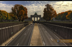 Driving Through Autumn (Erroba (feeling very sick)) Tags: road autumn trees brussels sky cars canon highway arch traffic belgium belgique belgi bruxelles erlend brussel jubelpark independanceday 60d erroba robaye