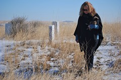Sharon walking around the headstones where each soldier fell during the battle of Little Bighorn (Julia R2012) Tags: snow headstones indians nativeamericans littlebighorn custer littlebighornbattlefield