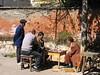Playing chess in Lijiang, Yunnan, China (mbphillips) Tags: 中国 丽江 lijiang 云南 yunnan 中國 fareast asia アジア 아시아 亚洲 亞洲 china 중국 mbphillips canonixus400 geotagged photojournalism photojournalist