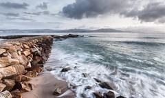 Otro espigon con seda (Perurena) Tags: sky clouds sand rocks waves arena cielo nubes olas seda pontevedra rocas rompeolas cangas espigon