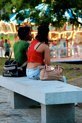 Among friends. (davidpompel) Tags: woman parkbench bostoncommon merrygoround canon