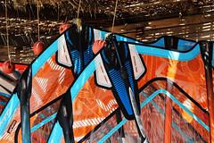sails (Katrinitsa) Tags: paros2016 paros greece greekislands island islands aegean mediterranean summer sail sailing sails shadows windsurfing windsurf surf watersports beach shore canon orange colors print shape cyclades kyklades traditional