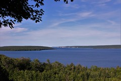 Grand Island Harbor (Jan Nagalski) Tags: scenic scenery blue green clouds deep depth harbor island cliffs forest trees water lake lakesuperior grandisland grandislandharbor munisingbay munisingharbor panoramicview shorelineshore picturedrocksnationallakeshore northernmichigan upperpeninsula puremichigan beauty nature naturalbeauty rugged michigan jannagalski jannagal leaves silhouette