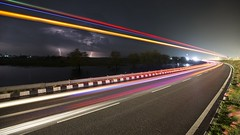 Thunders and light trails on  NH9 (Gireesh Reddy) Tags: andhra andhrapradesh telangana nature weather 1dx canon vijayawada hyderabad thunderstrom lighttrails longshutter thunders thunder lightning travel nightlife road night highway nh9