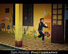 Jumping for Joy in the Ta Phin Village - Sapa, Vietnam (Sam Antonio Photography) Tags: school boy red portrait people color male smile yellow horizontal children asian outdoors happy togetherness jump jumping education asia southeastasia day vietnamese pattern village joy vietnam pa learning sa schoolchildren schoolhouse minority ta elation scenics sapa dzao oneperson phin contemplation traditionalculture tranquilscene ethnicminority travelphotography traditionalclothing ruralscene reddao taphin reddzao sapavietnam trekkinginsapa vietnamtravel vietnamchildren oneyoungboy laocaiprovince earthasia taphinvillage vietnamphotography canon5dmarkii samantonio jaymaiselquote