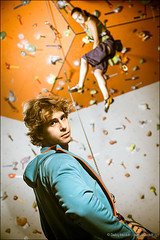 Young man belaying girls in climbing gym (Dmitry Mordolff) Tags: two people men sports beautiful rock wall female hair fun person healthy women hand tank risk friendship muscle muscular pair extreme watching lifestyle rope safety equipment indoors climbing health hanging leisure strength teaching activity care athlete harness gym partnership hold gripping teamwork caucasian belaying pushers exercising clambering